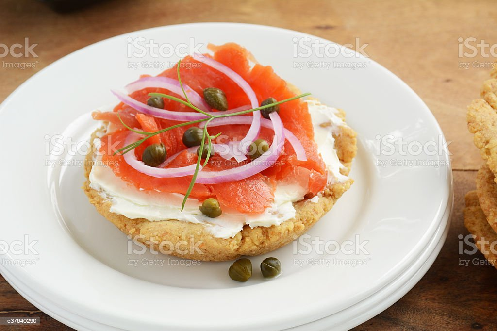 Gluten free biscuit with lox and cream cheese stock photo