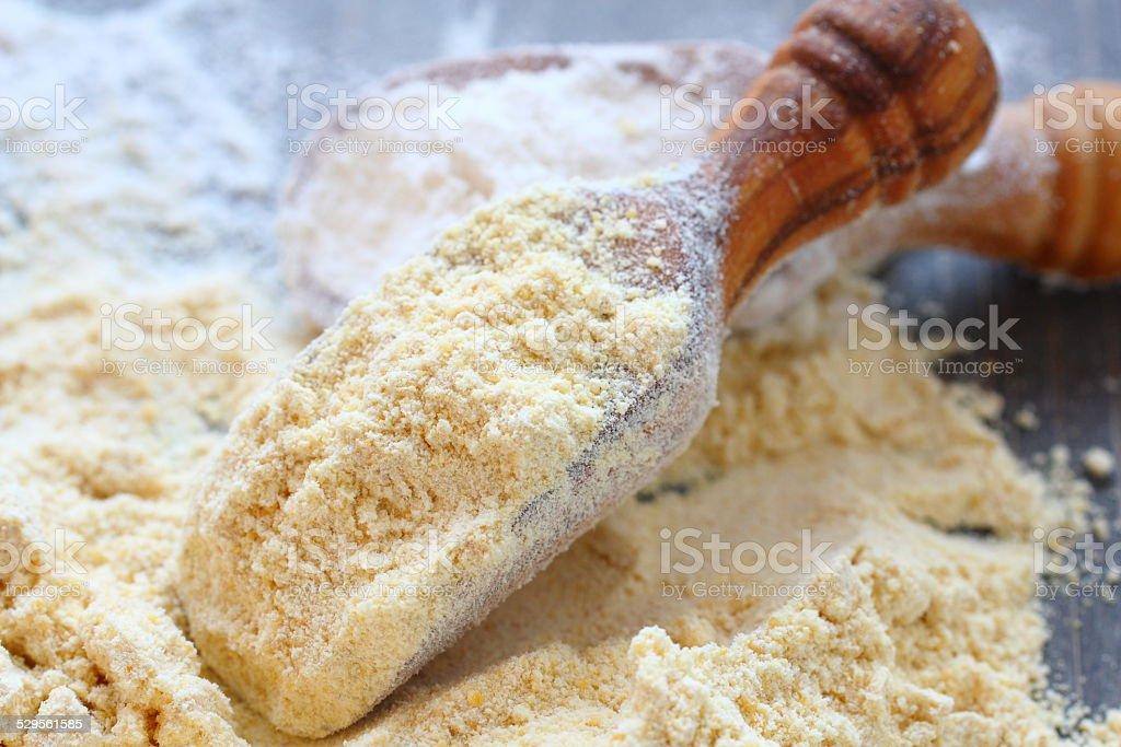 gluten free chickpeas flour in wooden scoop stock photo