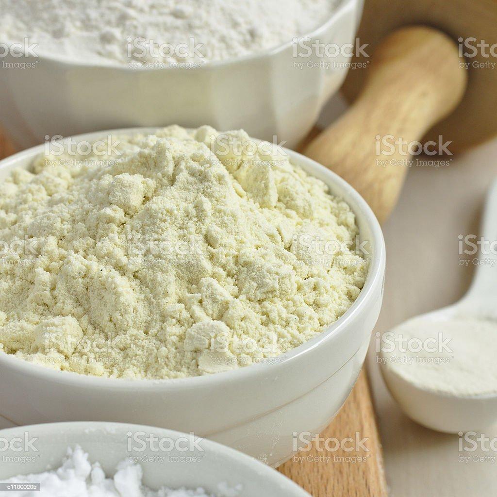 Gluten free millet flour in white bowl stock photo
