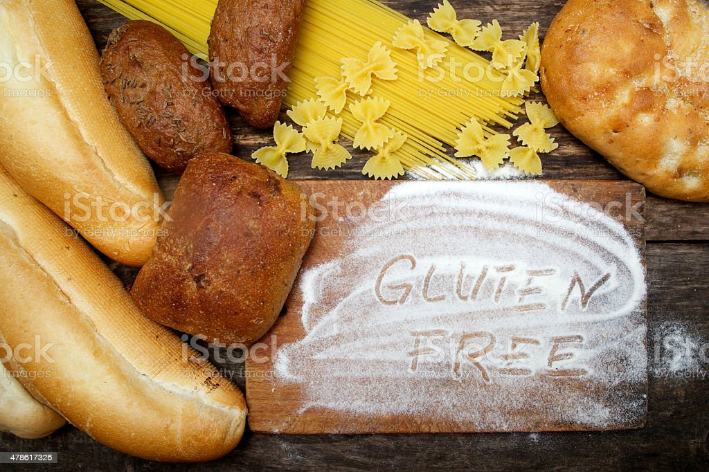 gluten free  word with bread on wood stock photo