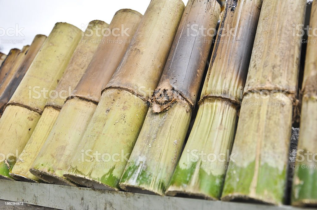 Glutinous rice roasted in bamboo joints famous dessert Thai food royalty-free stock photo