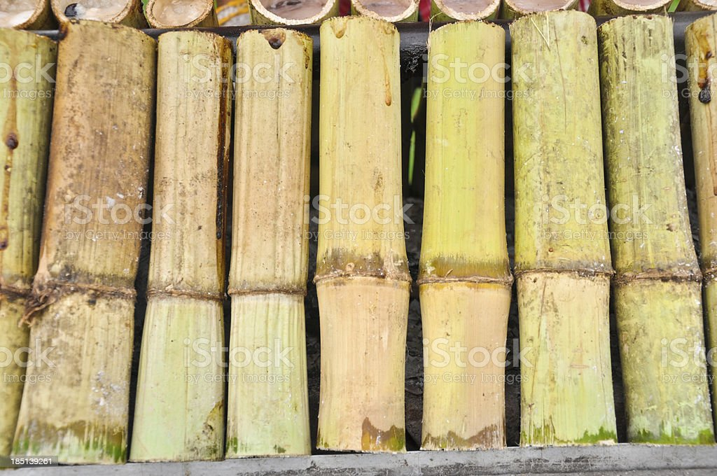 Glutinous rice roasted in bamboo joints famous Thai food royalty-free stock photo
