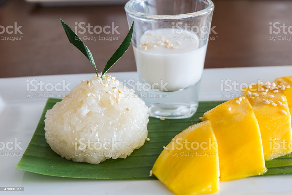 Glutinous rice with ripe mangoes, Thai style tropical dessert stock photo