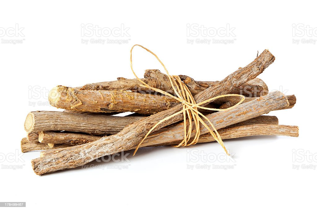 Glycyrrhiza glabra - bundled liquorice roots stock photo