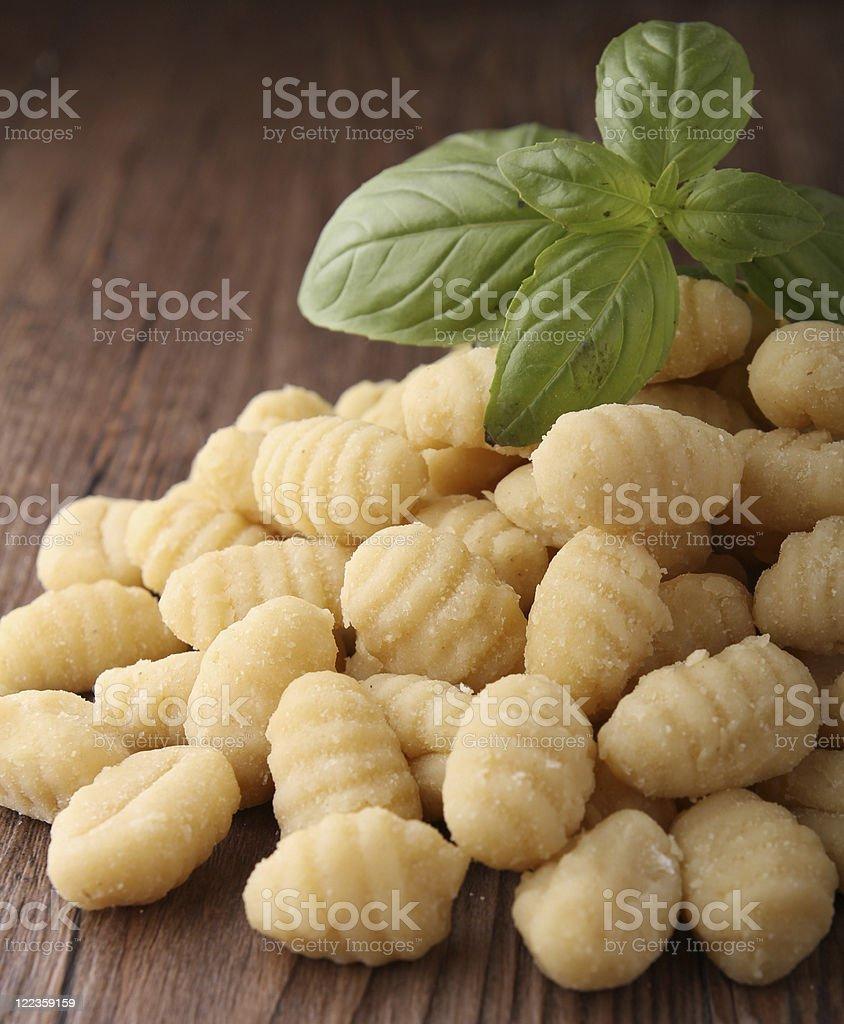 gnocchi and basil stock photo