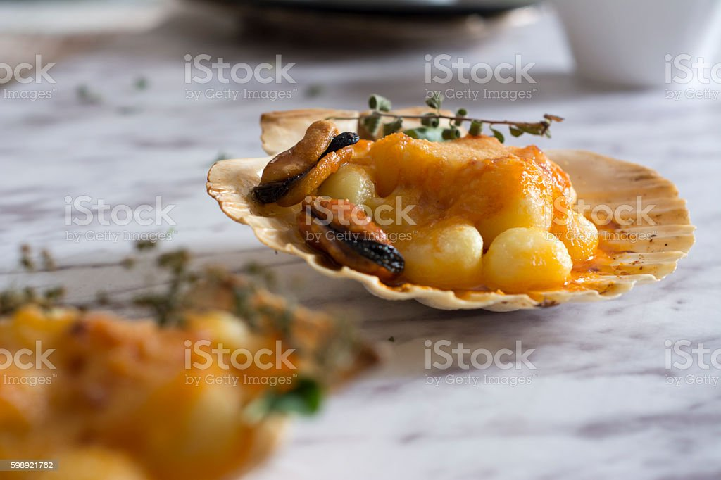 Gnocchi pasta with mussels, tomato and cream room stock photo