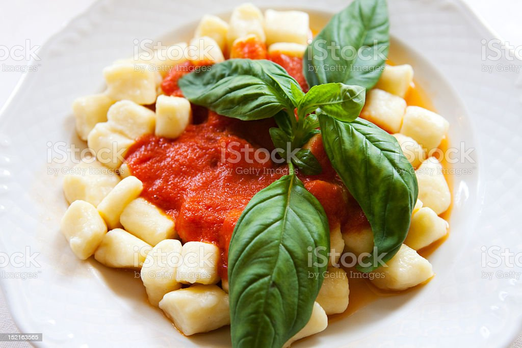 Gnocchi with basel and tomatoes stock photo
