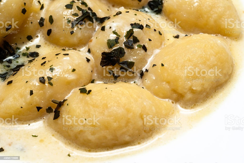 gnocchi with four cheese sauce stock photo