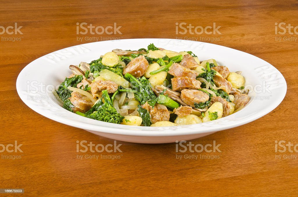 Gnocchi with Italian Sausages and Rapini stock photo