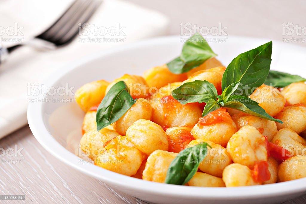 Gnocchi with tomato mozzarella and basil stock photo