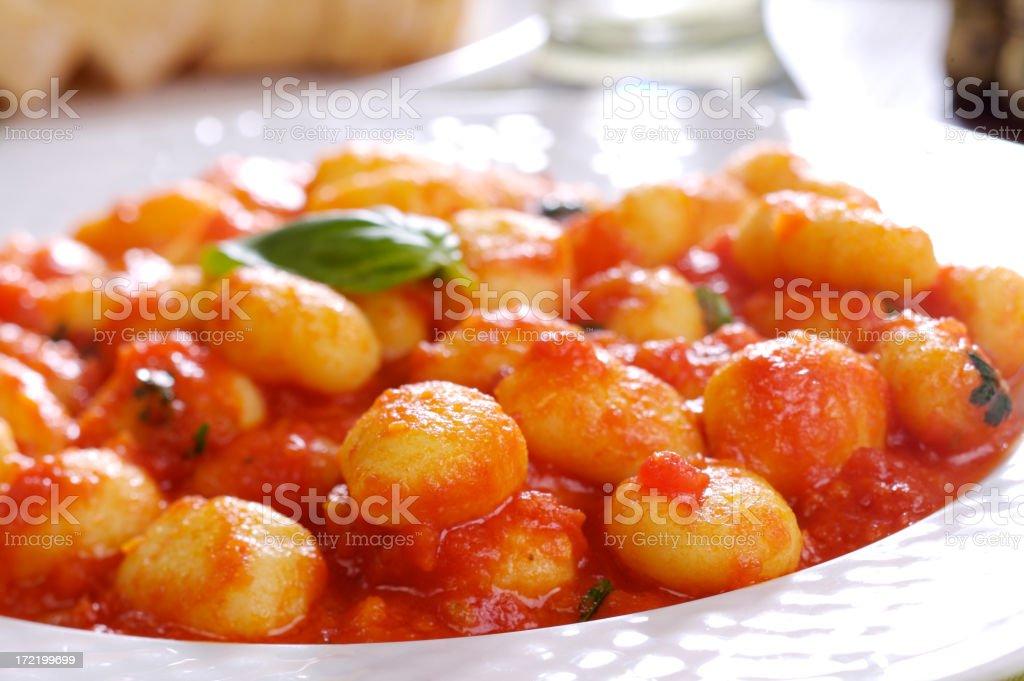 Gnocchi with tomato sauce stock photo