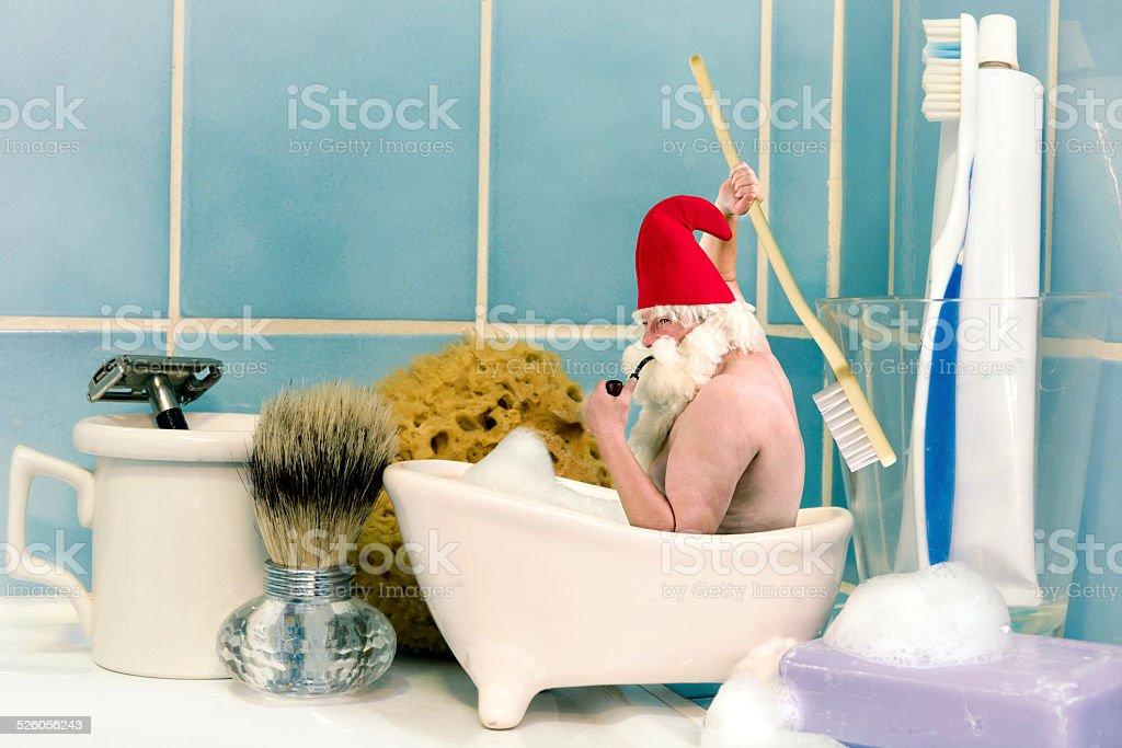 Gnome taking a bath stock photo