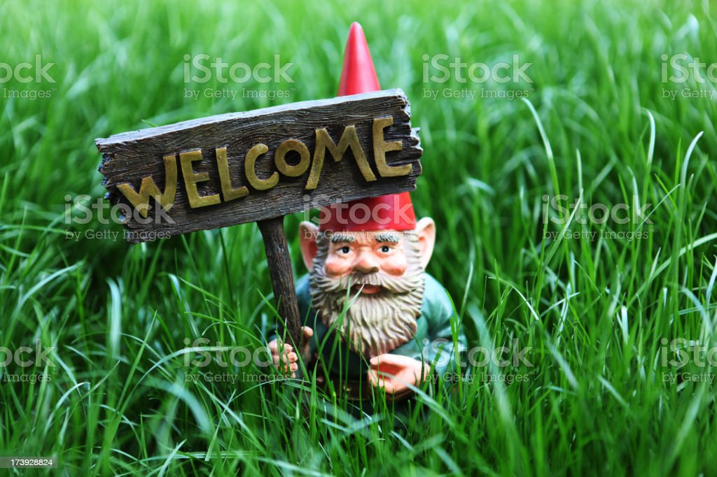 Gnome with welcome sign stock photo