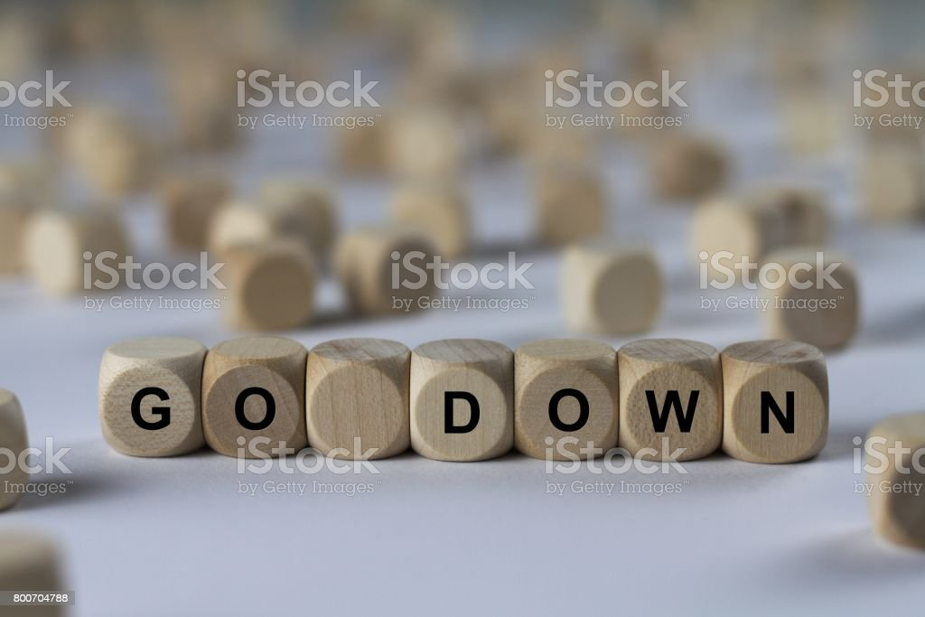 go down - cube with letters, sign with wooden cubes stock photo