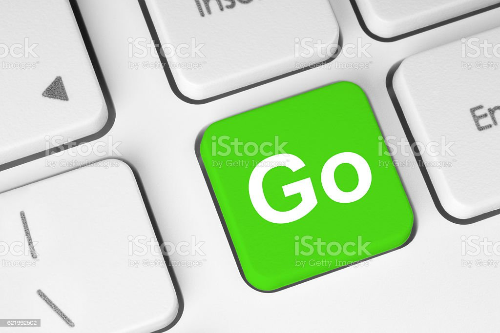 Go green button on keyboard stock photo