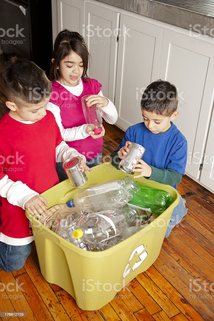 Go Green: Hispanic Siblings Recycling Together royalty-free stock photo