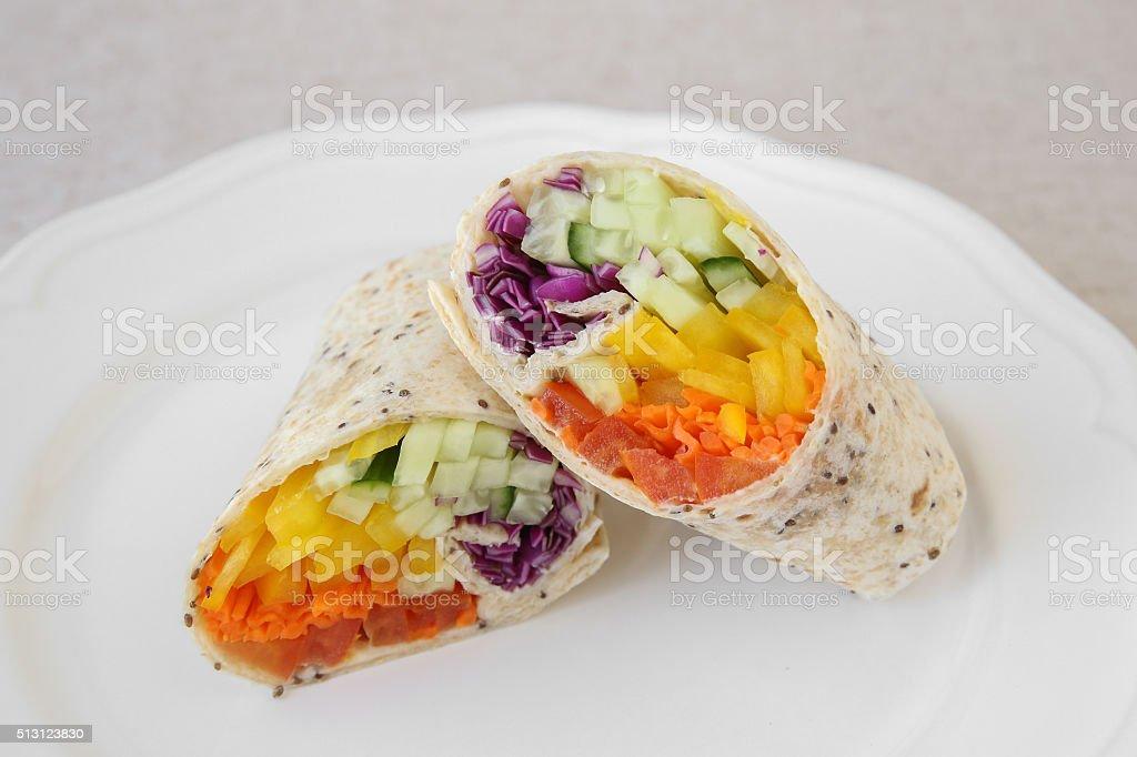 Go green, Rainbow salad tortilla wraps stock photo