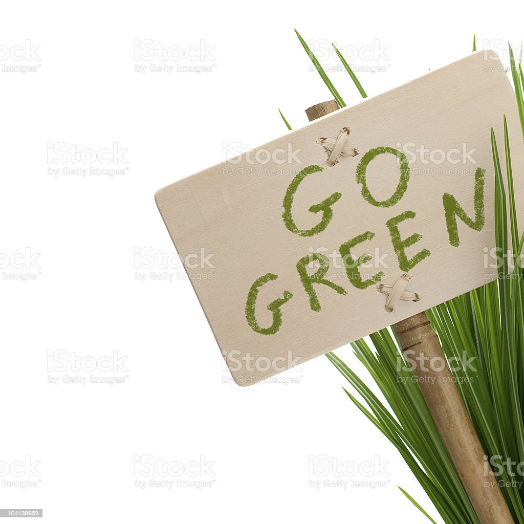 Go green sign with grass and post stock photo