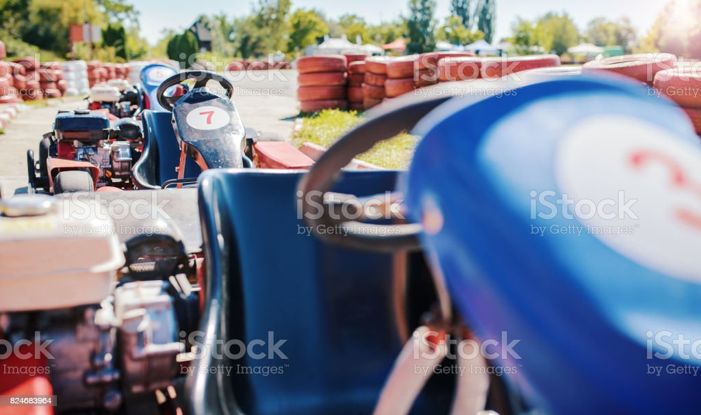 Go kart car parked next to track side stock photo