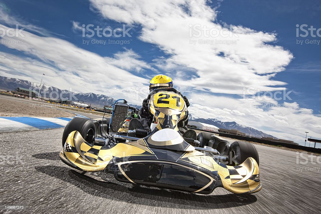 Go Kart Racer Speeding Around Track stock photo