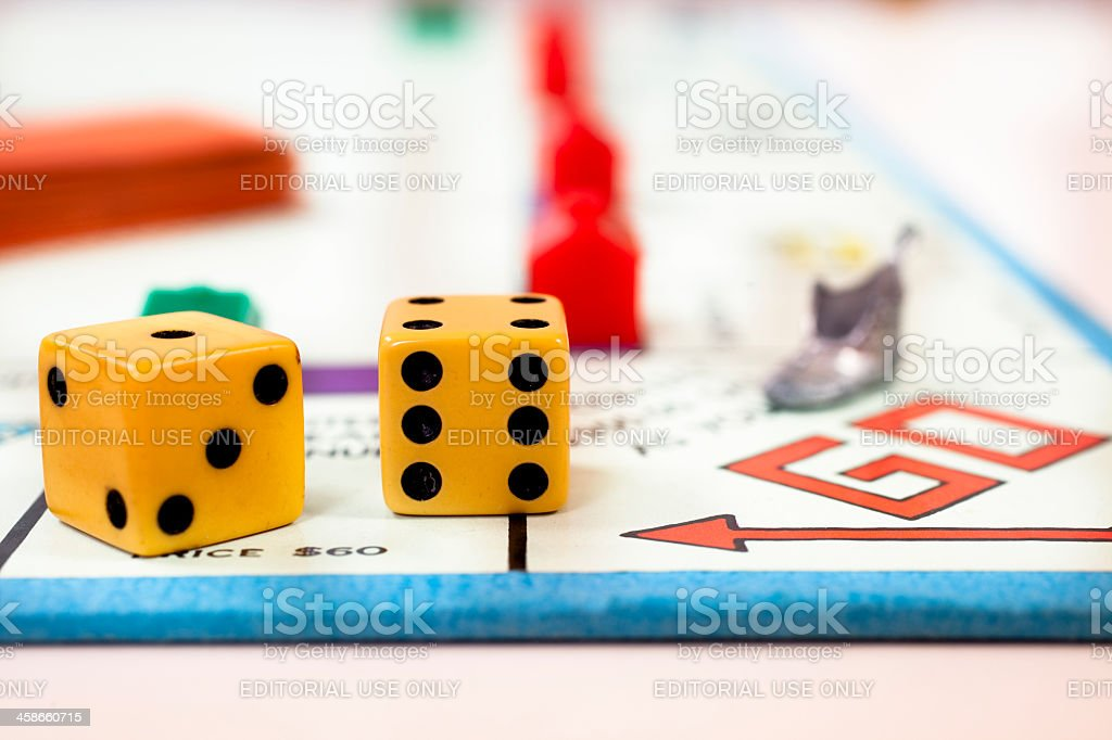 Go on a monopoly board with shoe and dice royalty-free stock photo
