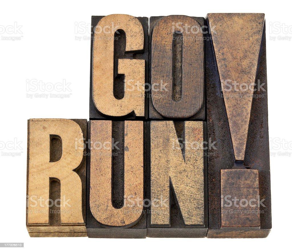 go run in letterpress wood type royalty-free stock photo