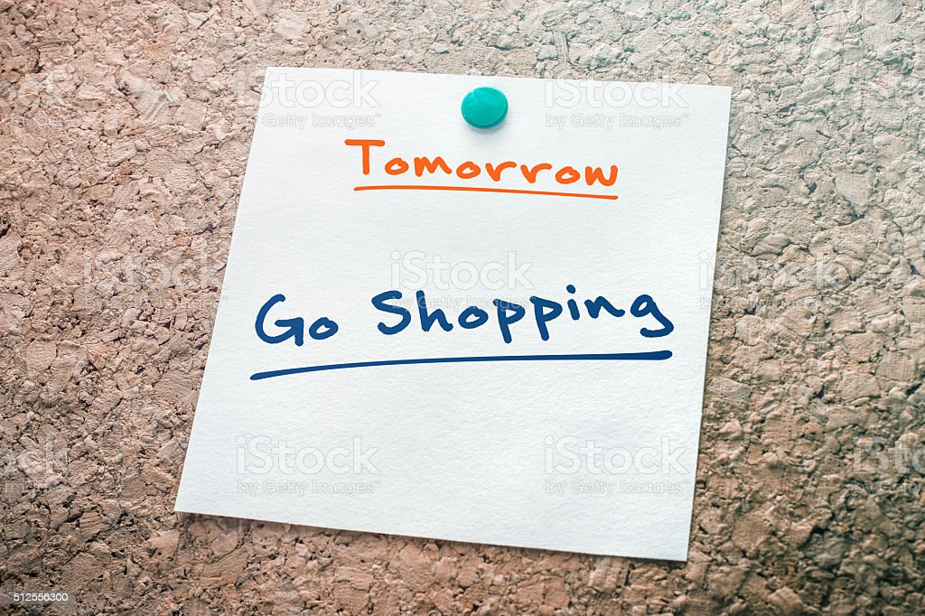 Go Shopping Reminder For Tomorrow Pinned On Cork Board stock photo