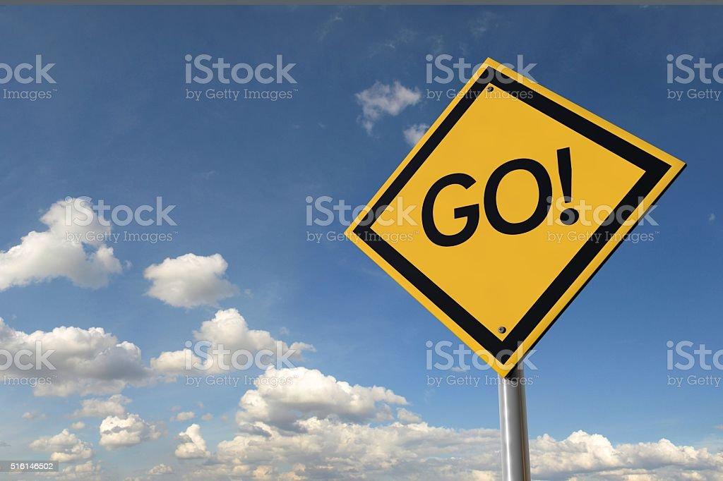 Go yellow highway road sign stock photo