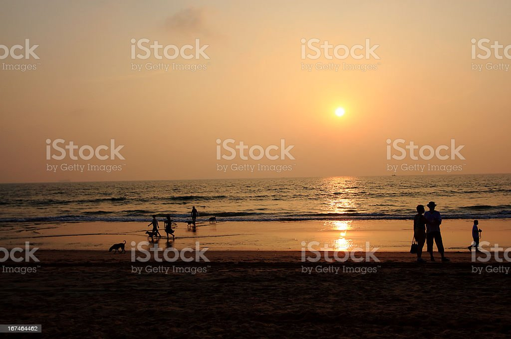 Goa Candolim beach people at sunset stock photo