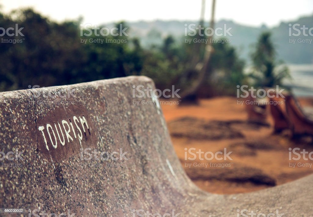 Goa, India. Bench with the word Tourism. stock photo