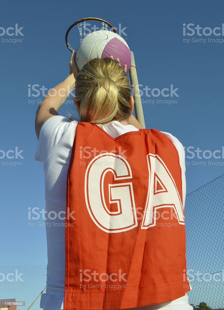 Goal attack shooting a netball royalty-free stock photo