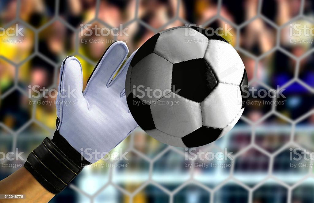 Goal keeper hand stopping a fast ball stock photo