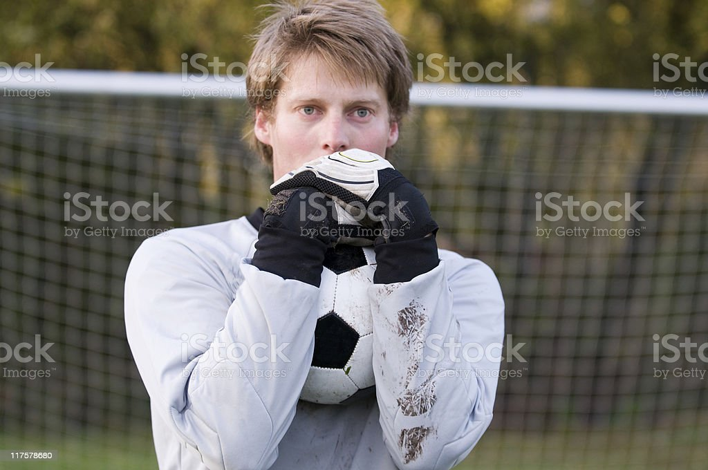 Goal keeper has a firm grib on the football royalty-free stock photo