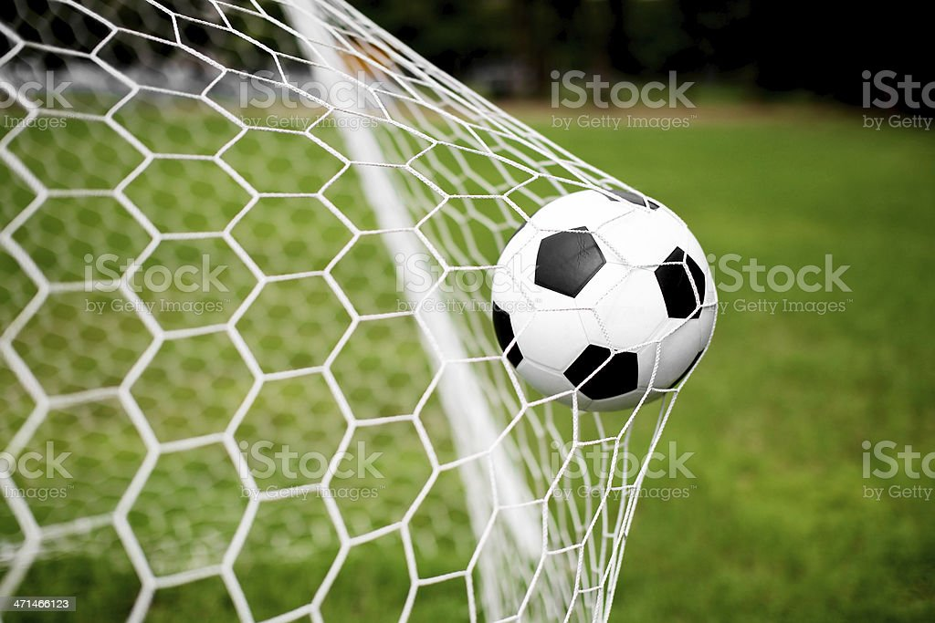 Goal net stretched by a scoring soccer ball stock photo