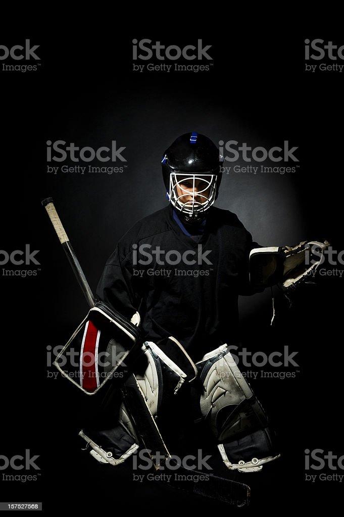 Goalie on a black background royalty-free stock photo