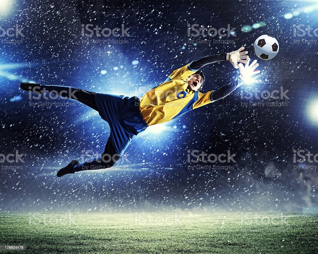 Goalkeeper catches the ball stock photo