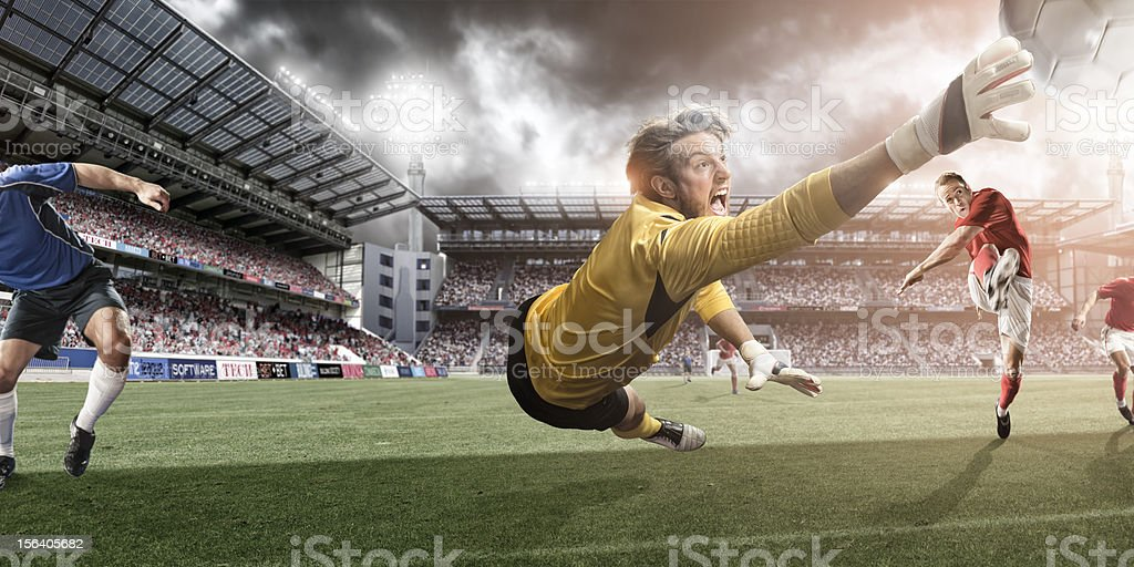 Goalkeeper Dives to Make Heroic Save stock photo