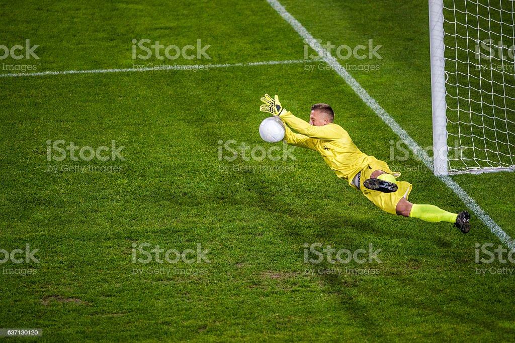 Goalkeeper diving stock photo