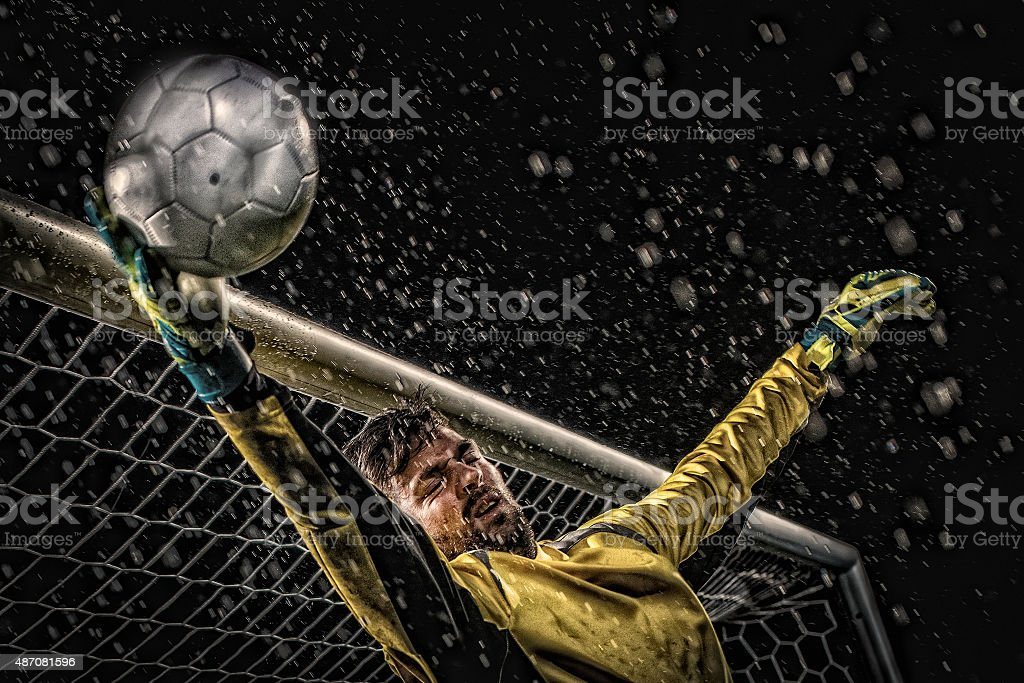 Goalkeeper diving to save goal stock photo