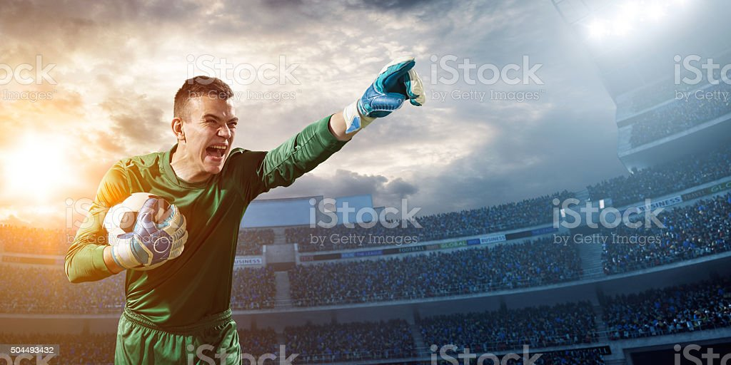 Goalkeeper gives directions stock photo