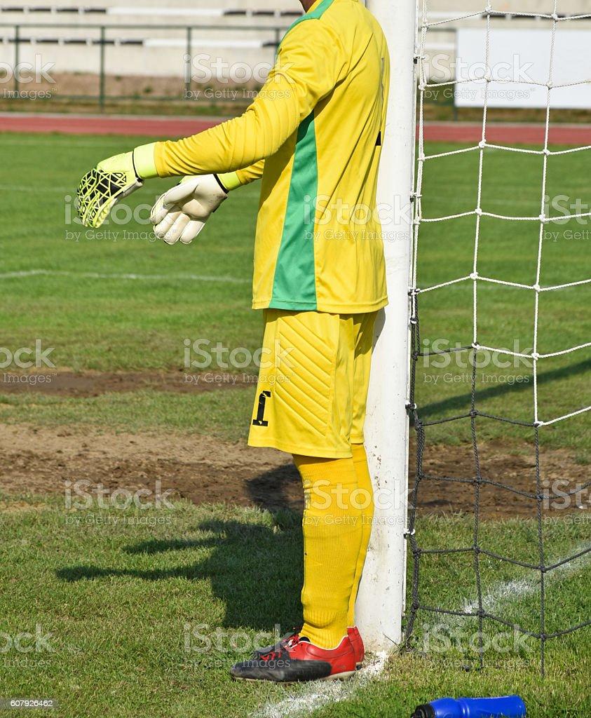Goalkeeper next to the goal stock photo