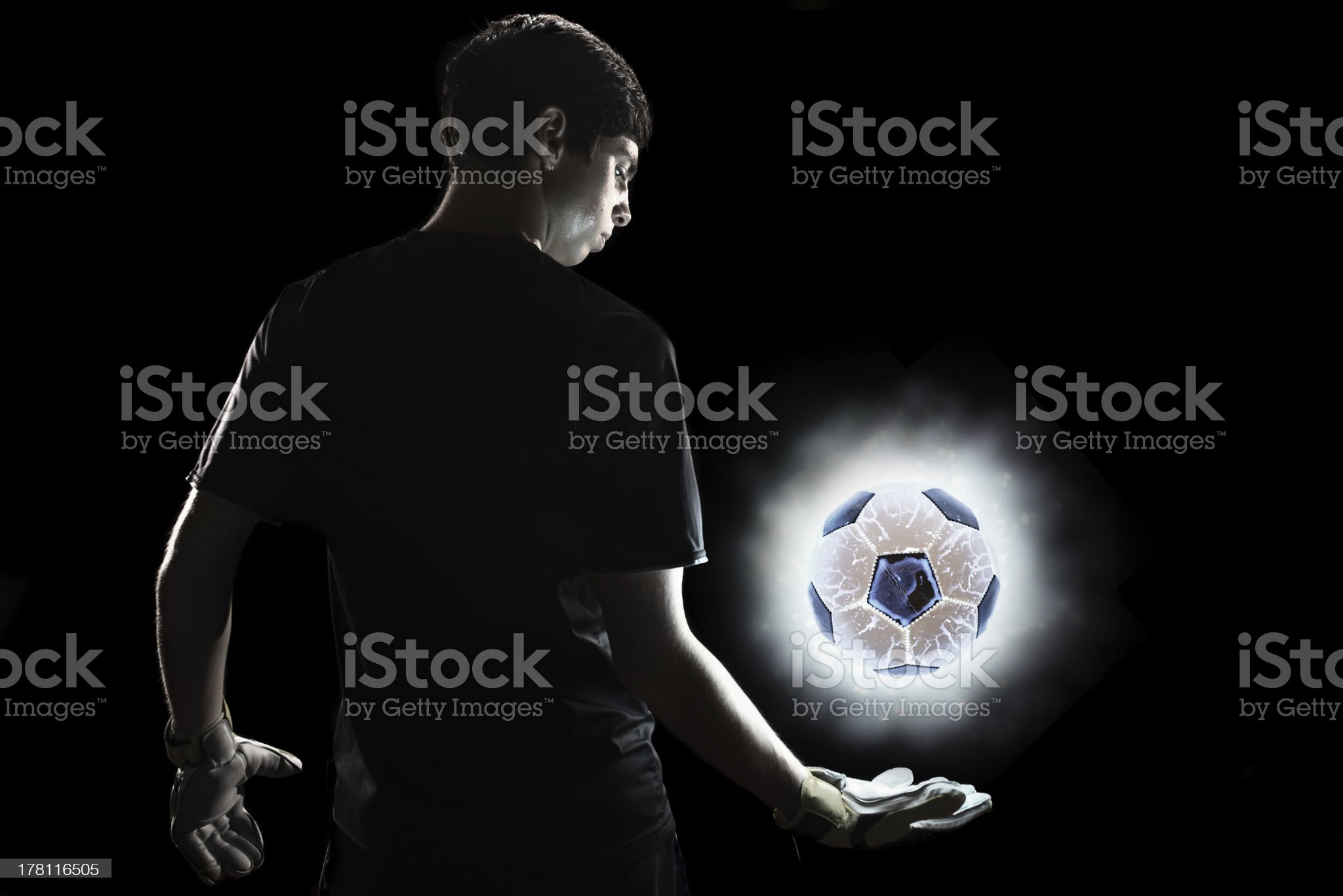 Goalkeeper standing with glowing ball royalty-free stock photo