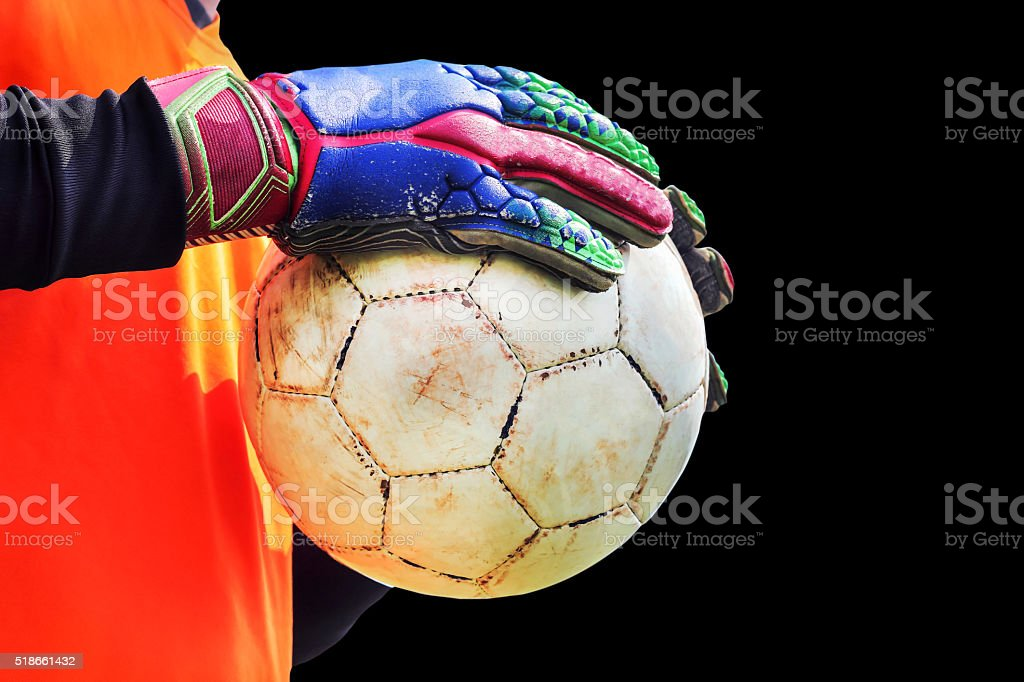 goalkeeper wearing gloves and holding ball. stock photo