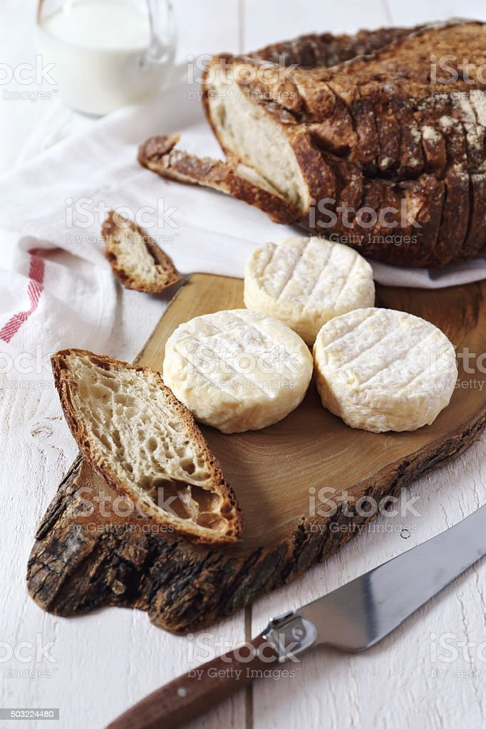 Goat cheese and  country  bread stock photo