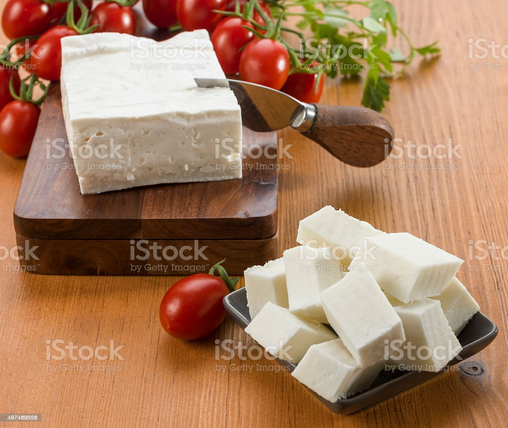 Goat cheese with sliced cubic pieces stock photo