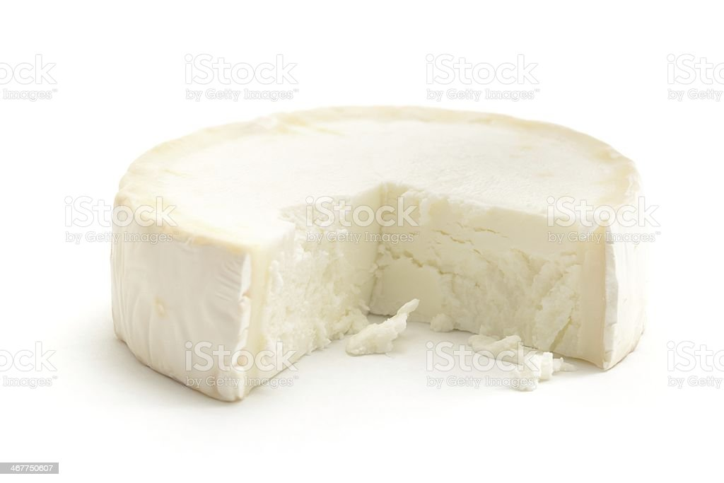 Goats cheese with missing slice stock photo