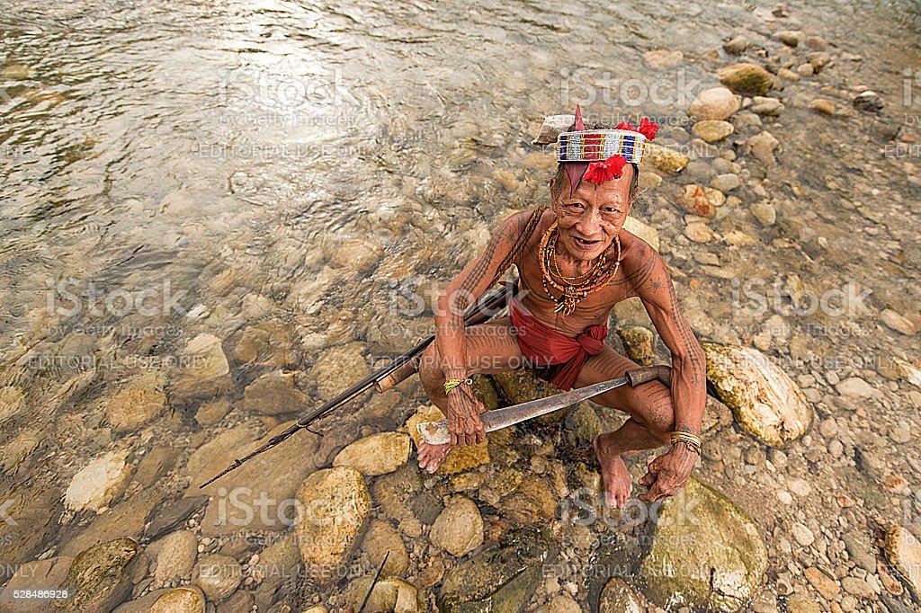 Gobbaik Toikod, 65, the Mentawai tribe pose for camera stock photo