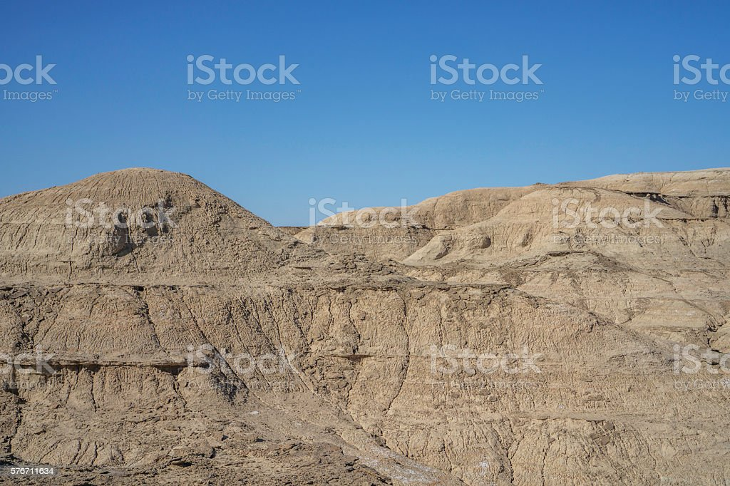 gobi and mountain under blue sky stock photo