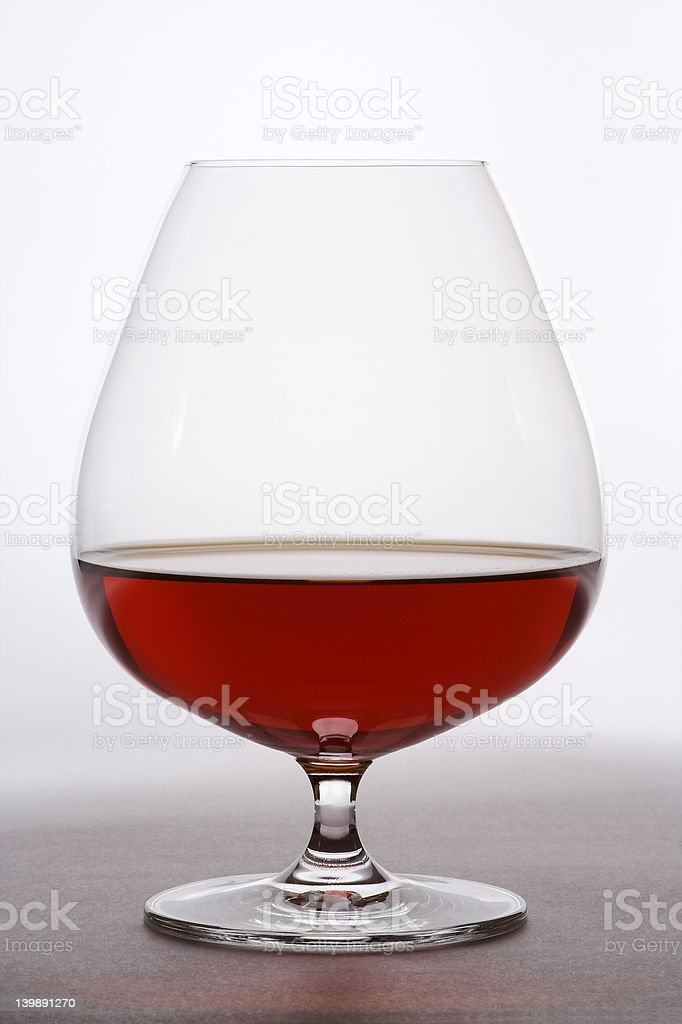 Goblet with strong drink stock photo