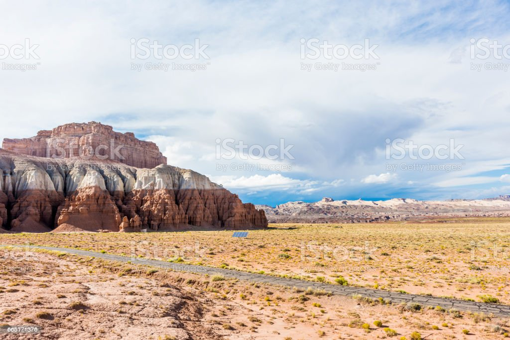 Goblin Valley State Park Canyon with white and red layers with solar panel in desert in Utah stock photo